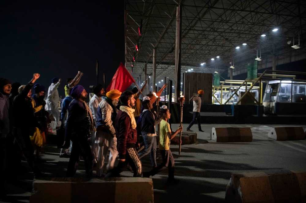 A Mashal March (torch march) at a toll plaza near Jalandhar, Punjab. Toll Plazas have been blockaded throughout the state.