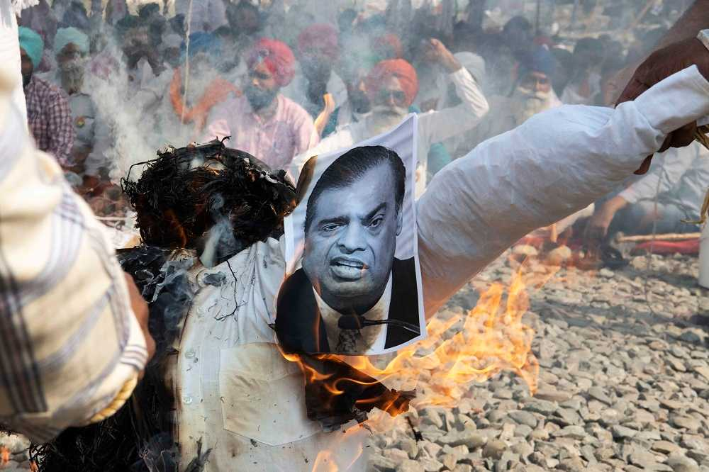 Mukesh Ambani's effigy is burnt along with those of Gautam Adani, Narendra Modi, and Captain Amarinder Singh. Ambani and Adani are considered to be the masterminds behind the new ordinances.